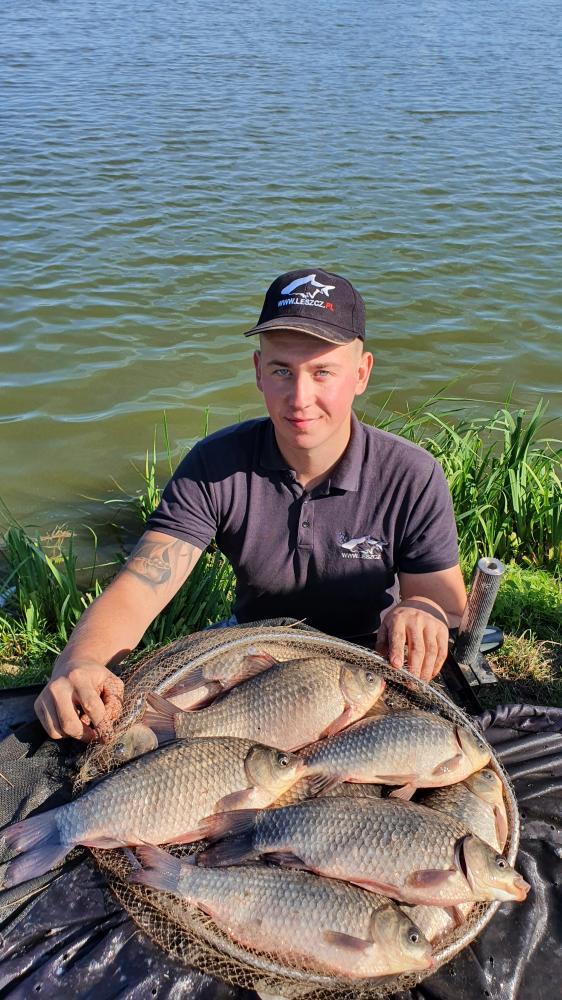Daniel Kożuchowski z rybami
